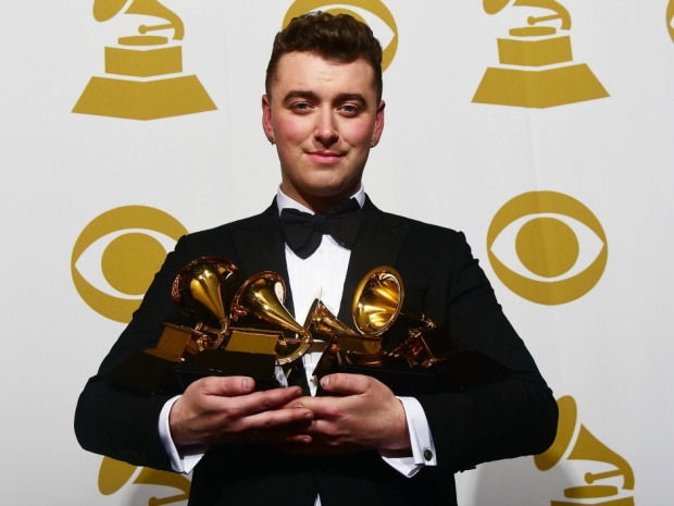 Sam Smith holds his four awards in the press room at the 57th annual Grammy Awards in Los Angeles, California on February 8, 2015. AFP PHOTO/FREDERIC J. BROWNFREDERIC J. BROWN/AFP/Getty Images